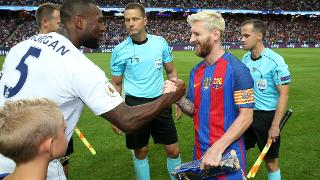Wes Morgan and Lionel Messi