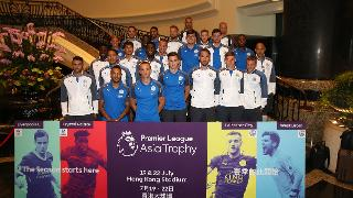 The squad pose for a picture on arrival in Hong Kong