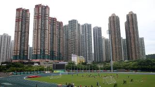 The Foxes train under the Hong Kong sky line