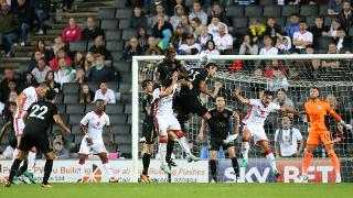 Leicester City defend a corner against MK Dons