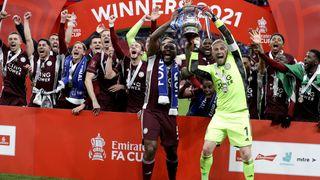 Wes Morgan & Kasper Schmeichel lift the FA Cup